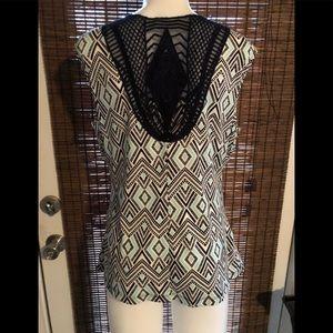 Sleeveless blouse by Alyx. Crotchet back.